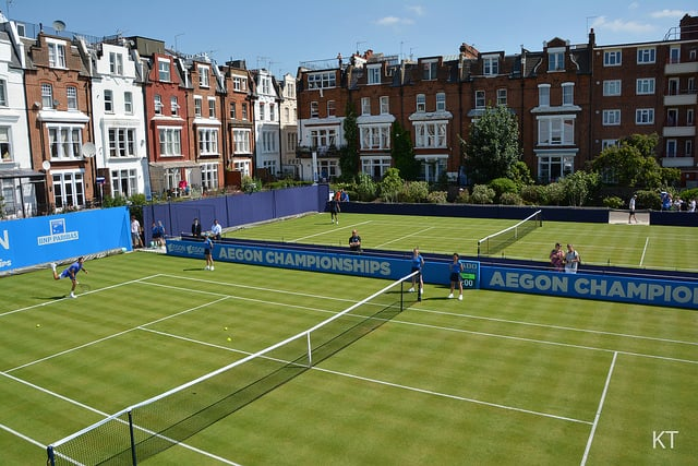 photo of some grass tennis courts