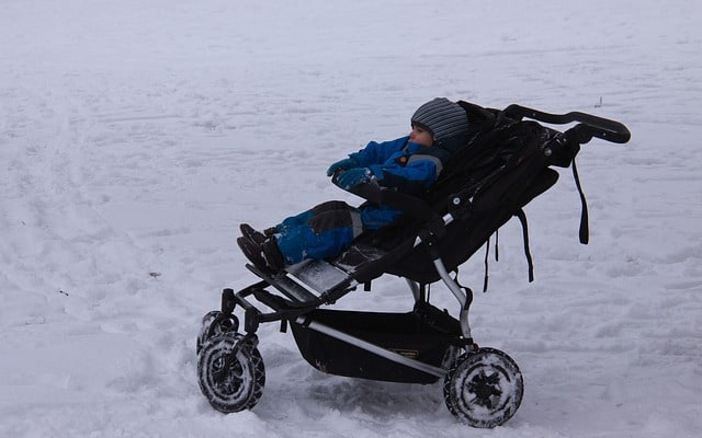 4 wheel stroller in the snow