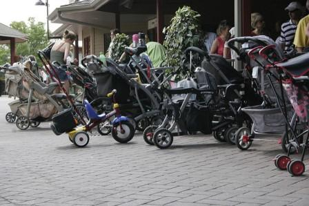collection of strollers outside a cafe