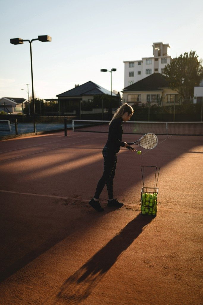 tennis serve practice on a clay court