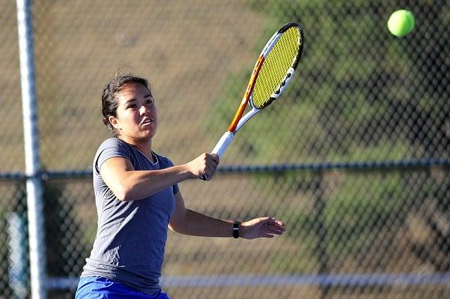 tennis player hitting a shot