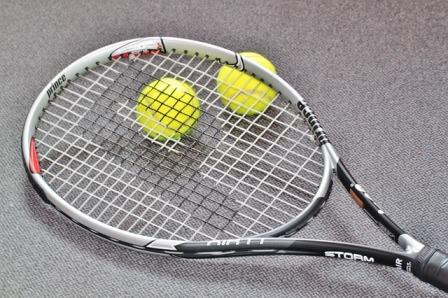 tennis racquet and two balls