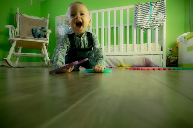 boy sitting on floor in nursery