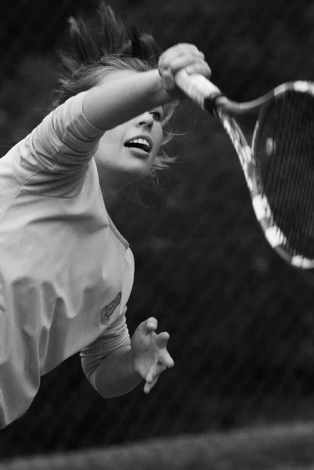 tennis serve woman black and white photo