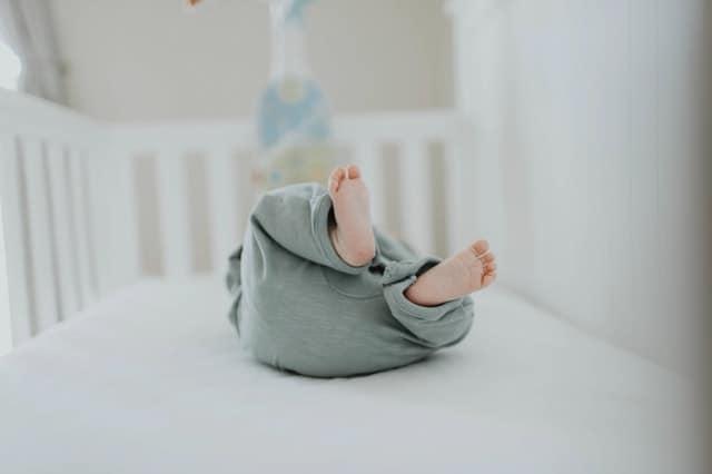 baby lying down in crib