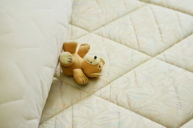soft toy on mattress