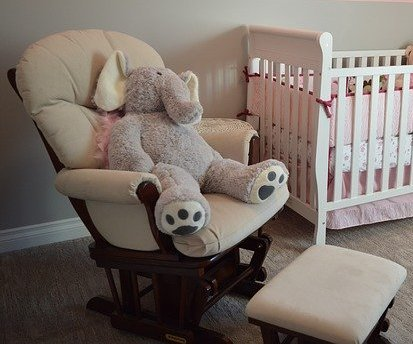 nursery chair with elephant toy