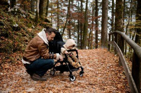 dad with baby and stroller