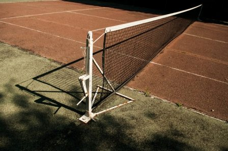 old tennis court in poor condition