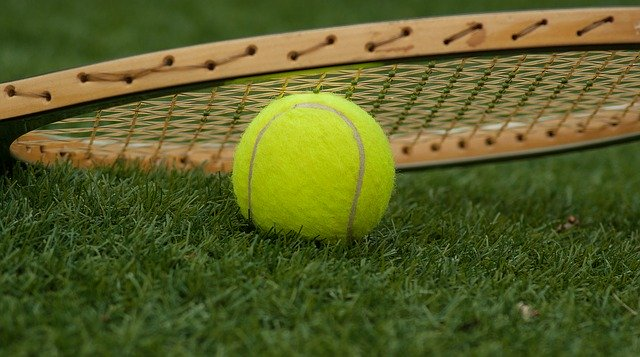 tennis ball and wooden racquet