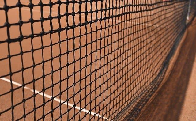 tennis net on clay court