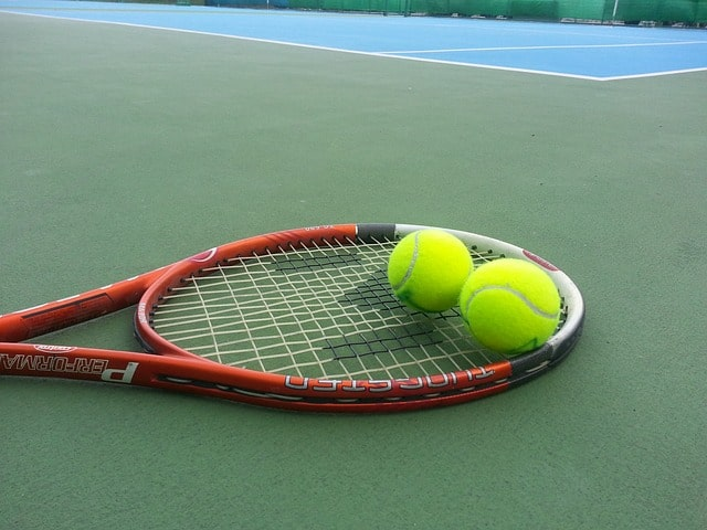 tennis racket with two balls