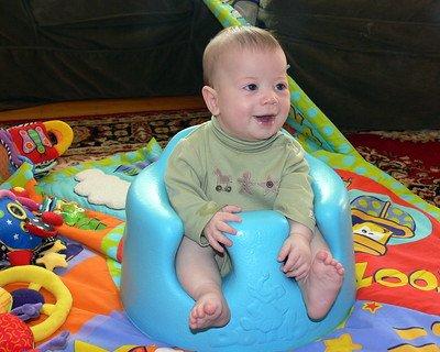 boy in blue Bumbo seat
